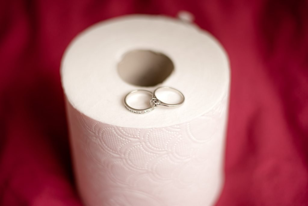 The wedding rings placed upon toilet roll