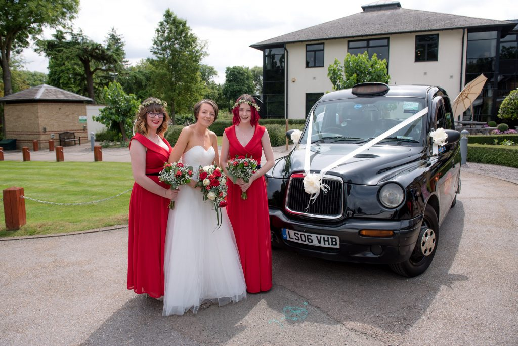 The bride standing outside a london black cab