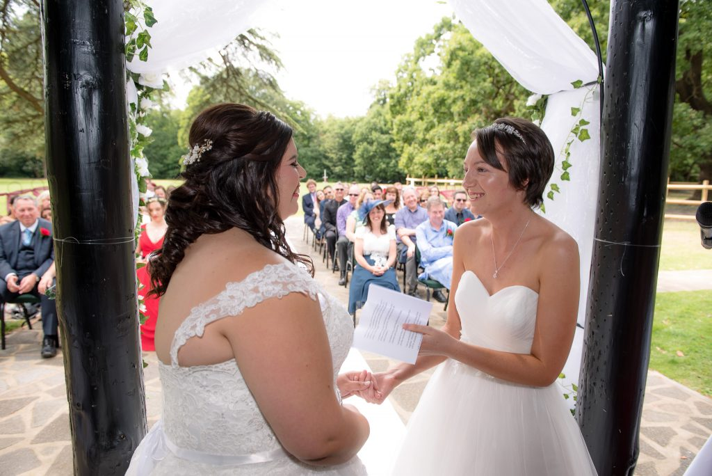The brides reading their own vows
