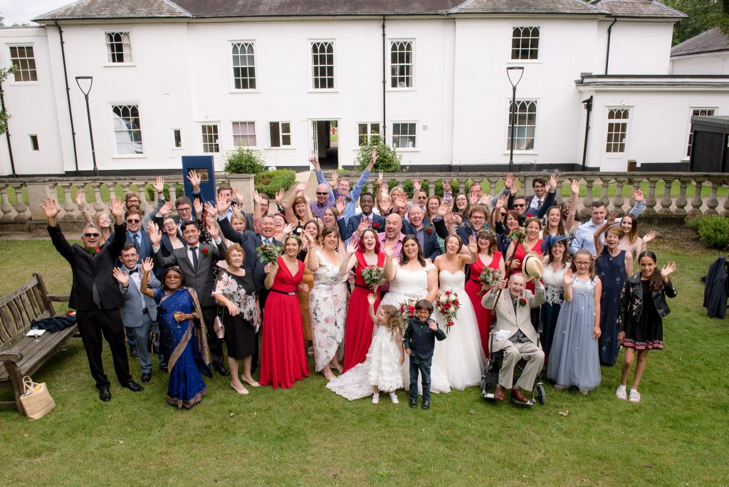 A group shot of all guests at the Gilwell Park Wedding Venue