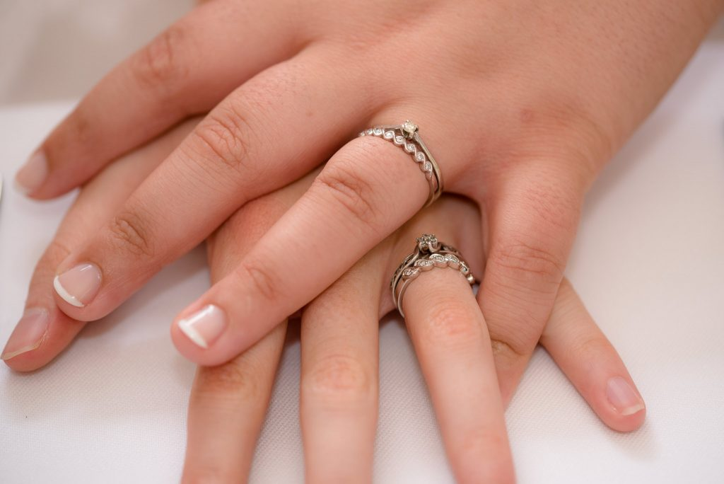 The wedding rings of the two brides