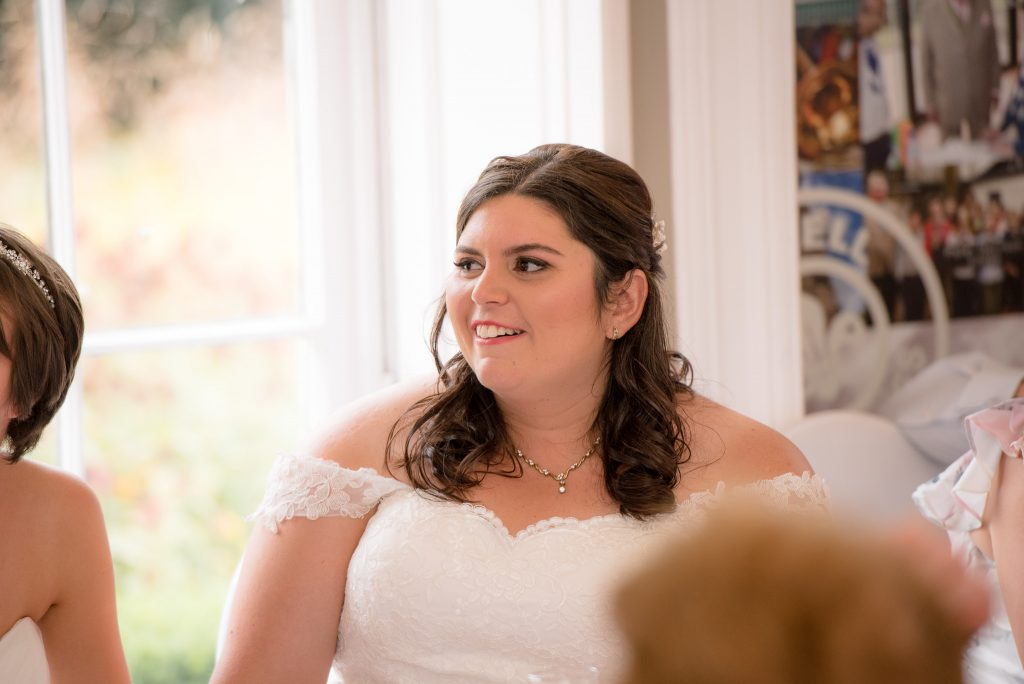 The bride laughing at the speeches