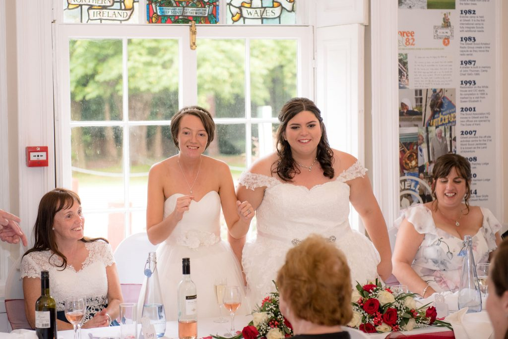 The two brides deliver a speech
