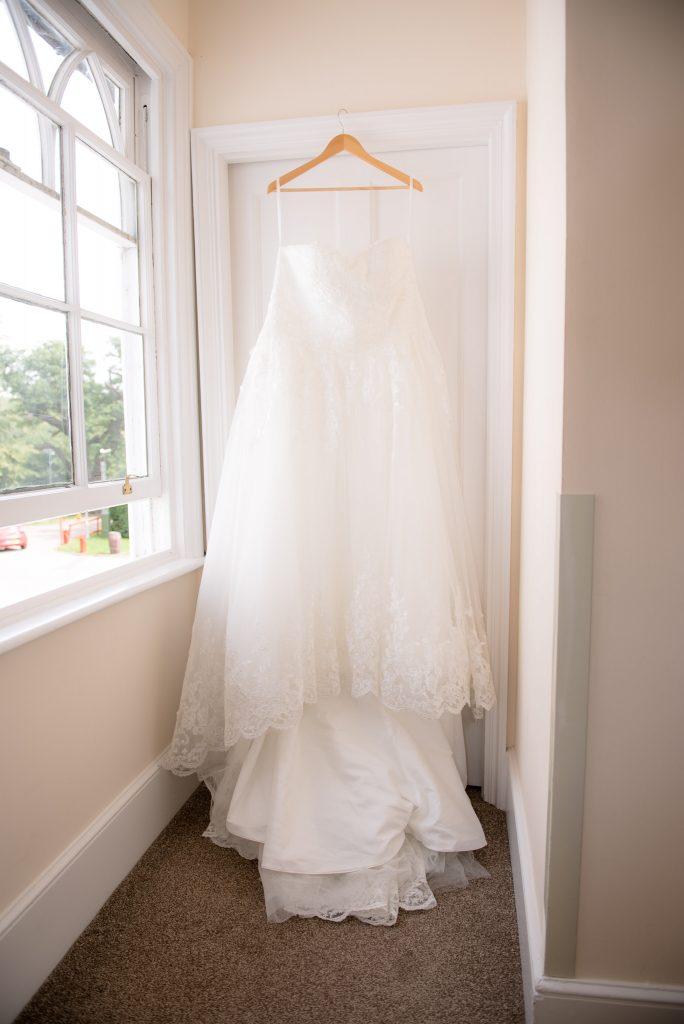 Wedding dress hanging from a door