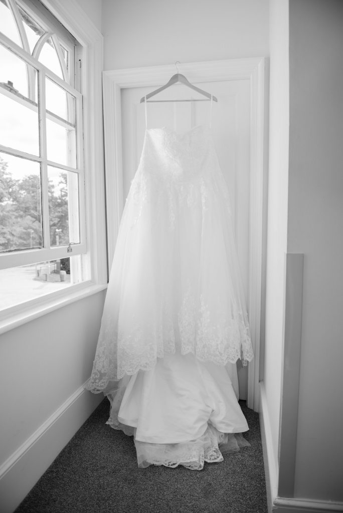 A black and white photo of the wedding dress