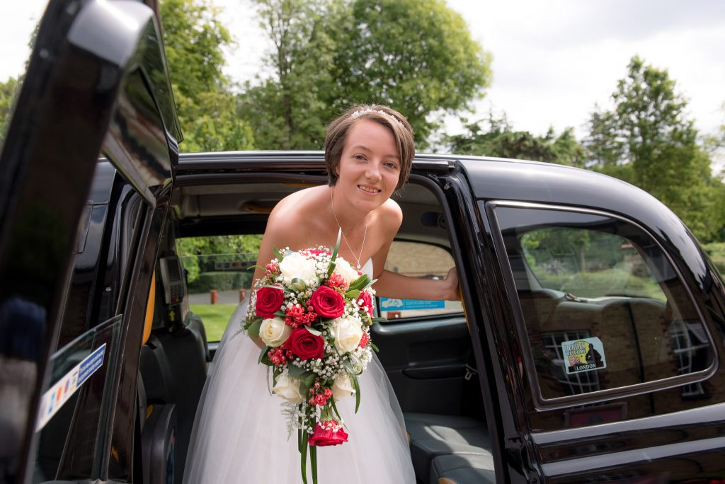 The bride exiting the london cab