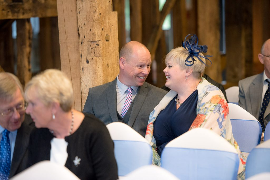 Wedding guests inside the Tythe Barn
