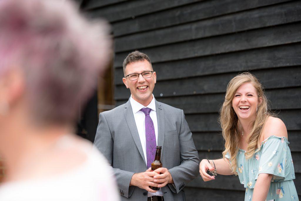 Wedding guests share a joke together