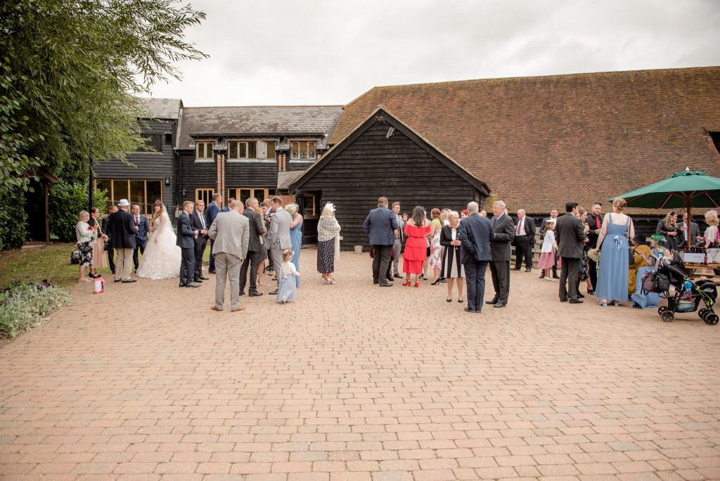 Wedding guests outside the Tythe Barn