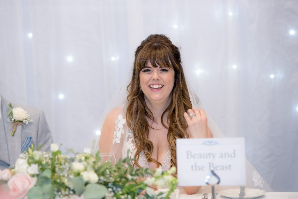 The bride laughs at the speeches