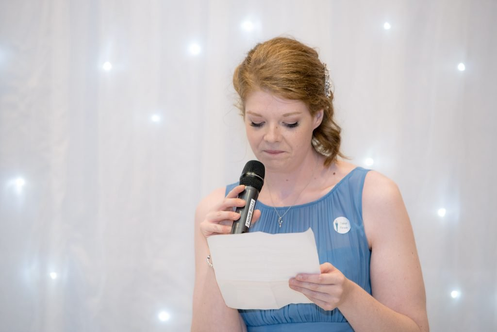 A bridesmid delivers her speech