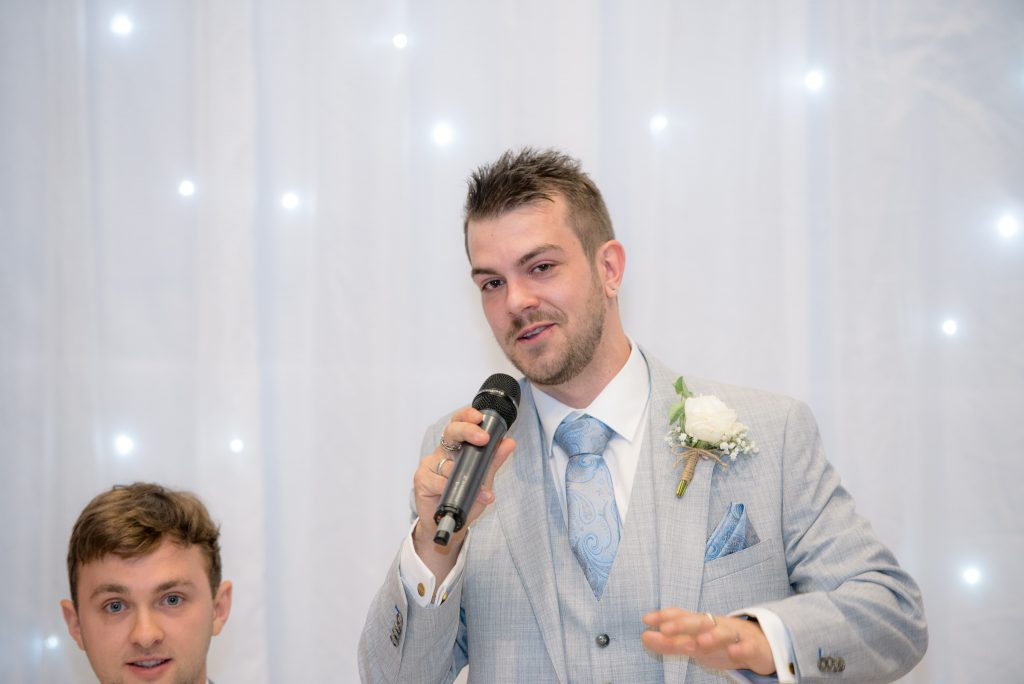 The groom delivers his speech