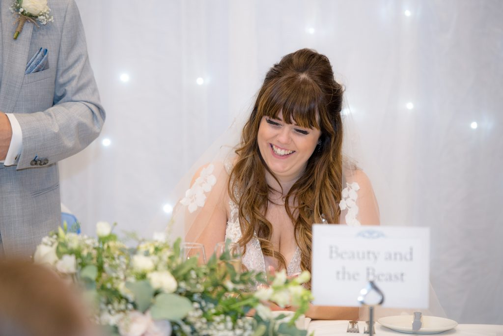 The bride laughs at the groom