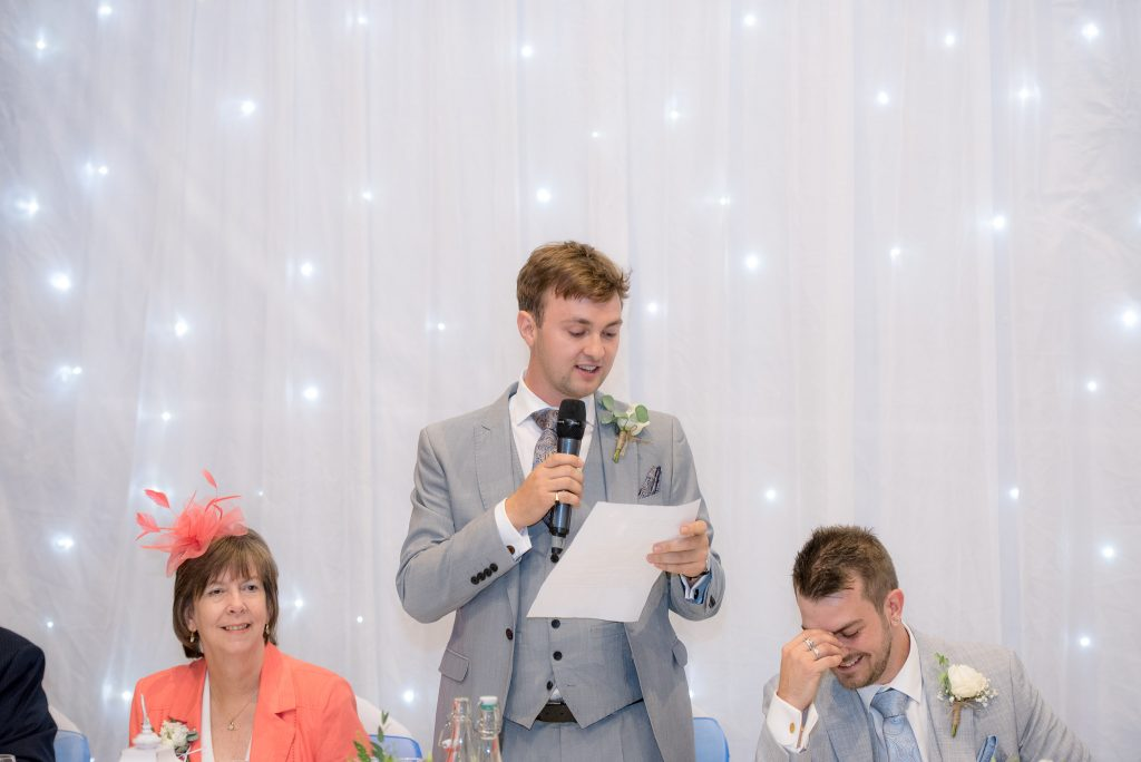 The best man delivers his speech