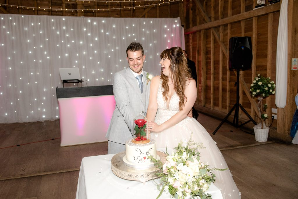 The bride and groom cut the cake at Tewin Bury Farm
