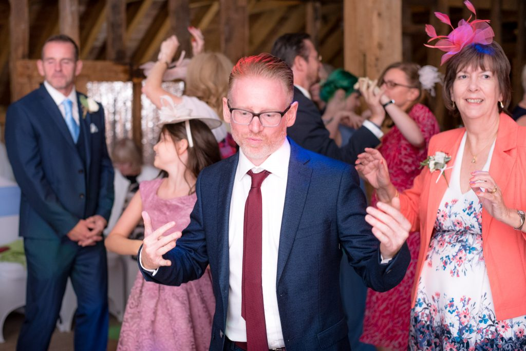 Wedding guests dancing at Tewin Bury Farm