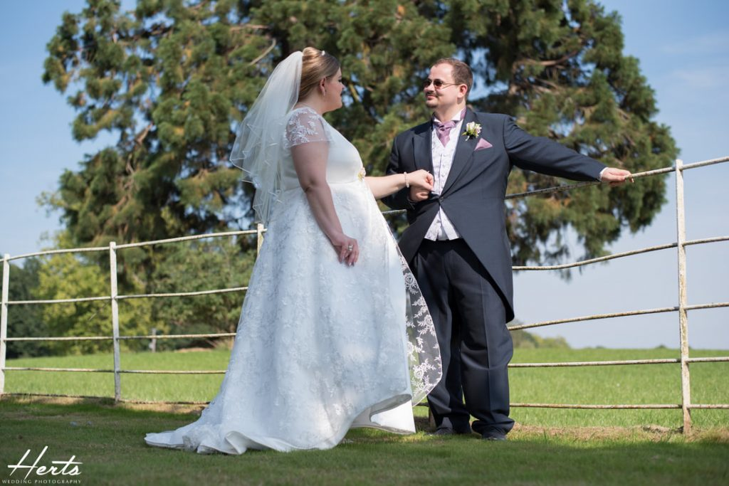 The bride and groom look relaxed at Gosfield Hall