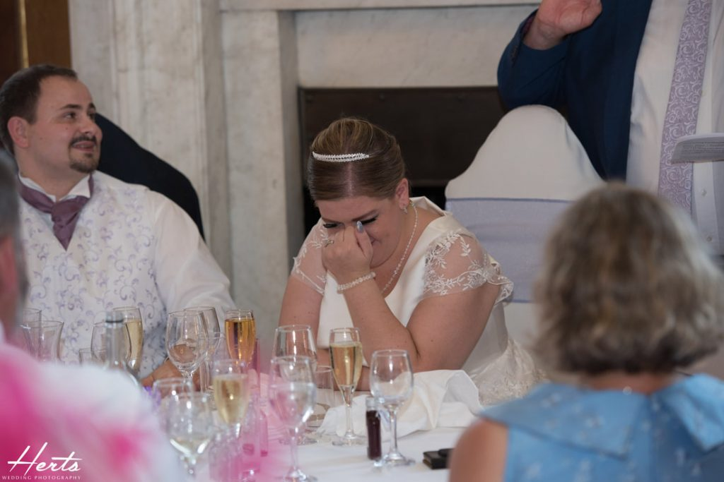 The bride cries with laughter