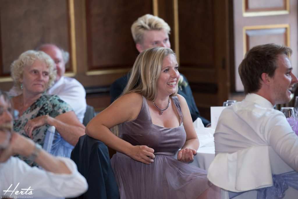 The sister of the bride enjoys the speeches
