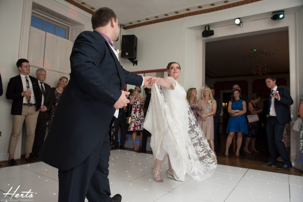 The bride and groom perform their first dance together at Gosfield Hall