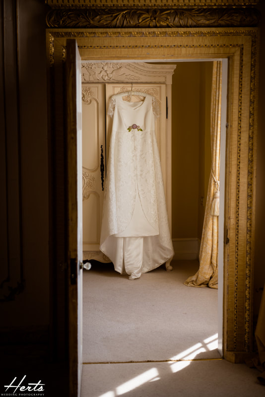 The wedding dress hangs on a wardrobe