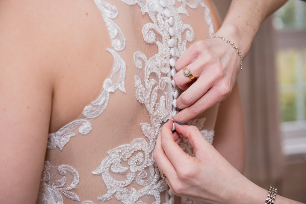 Buttoning of the wedding dress