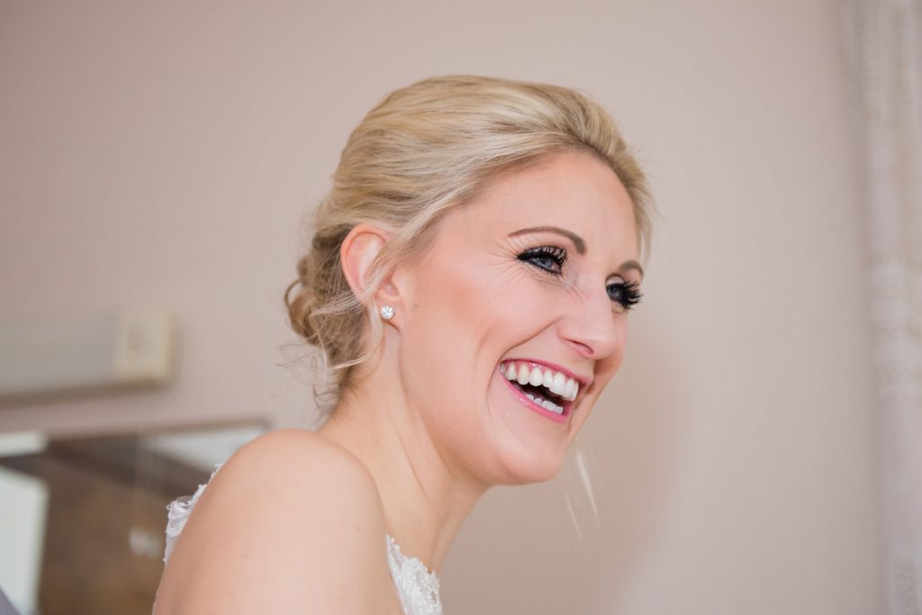The bride smiling