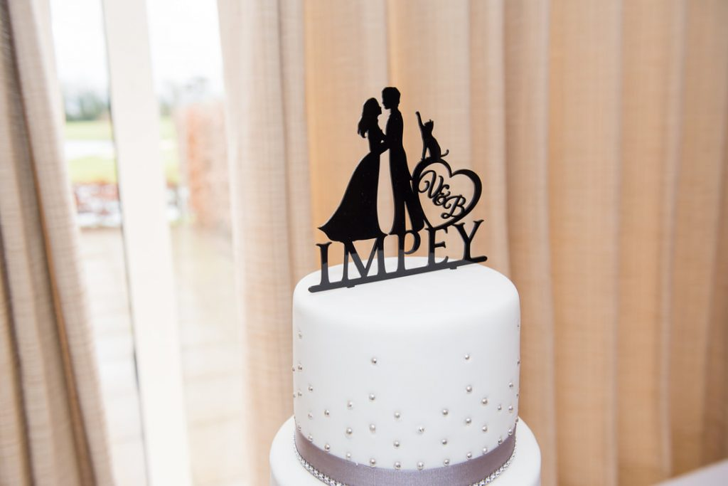 Wedding Cake Topper of a couple with a cat