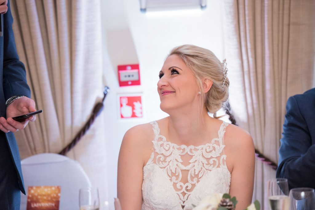 The bride smiles at her new husband