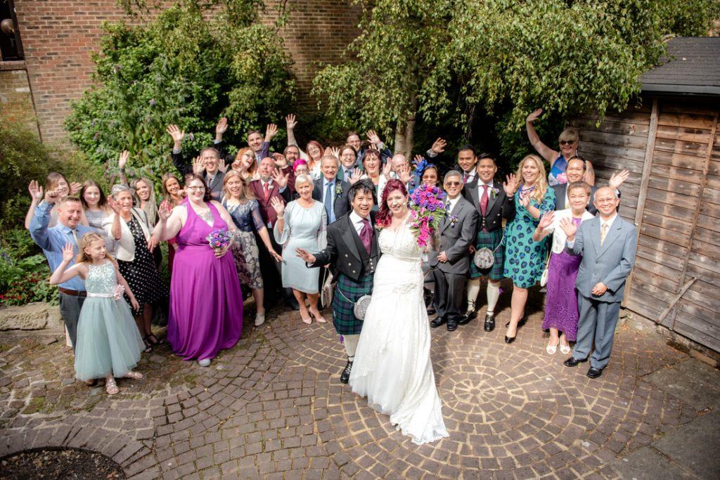 All the guests waving at the camera