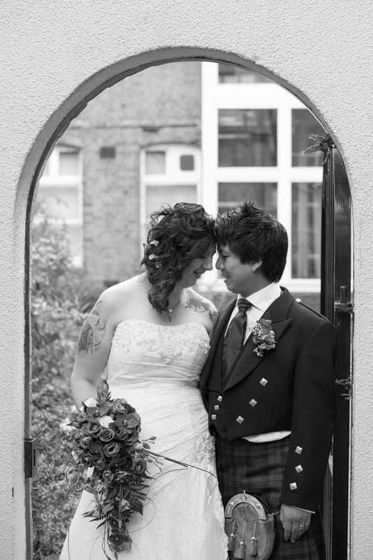 An emotional picture of the bride and groom in Berkhamsted