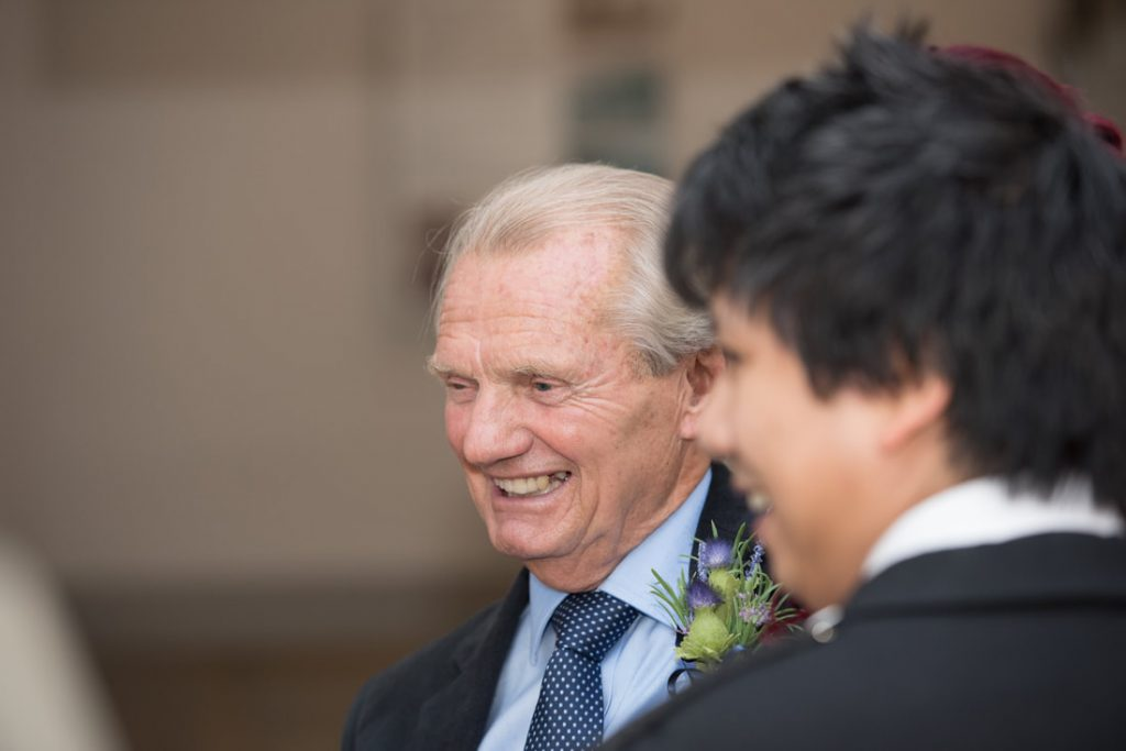 A wedding guest laughing