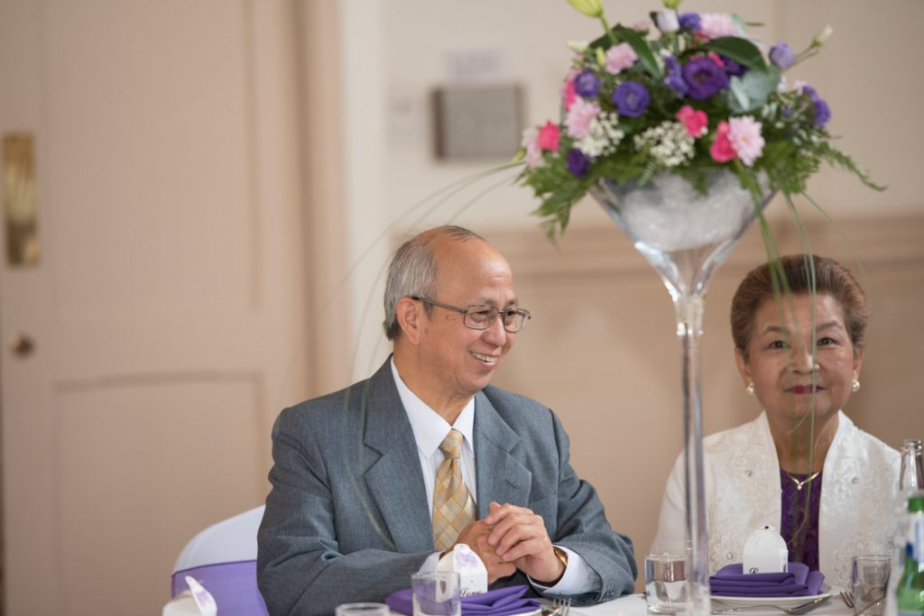 A wedding guest smiling in Berkhamsted
