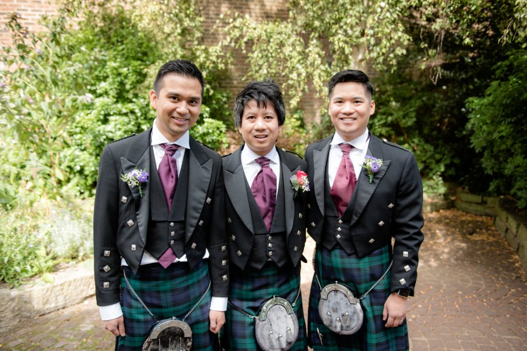 The groom and his best men wearing kilts