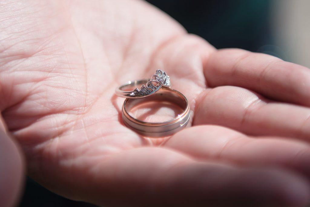 Wedding rings in the grooms hand