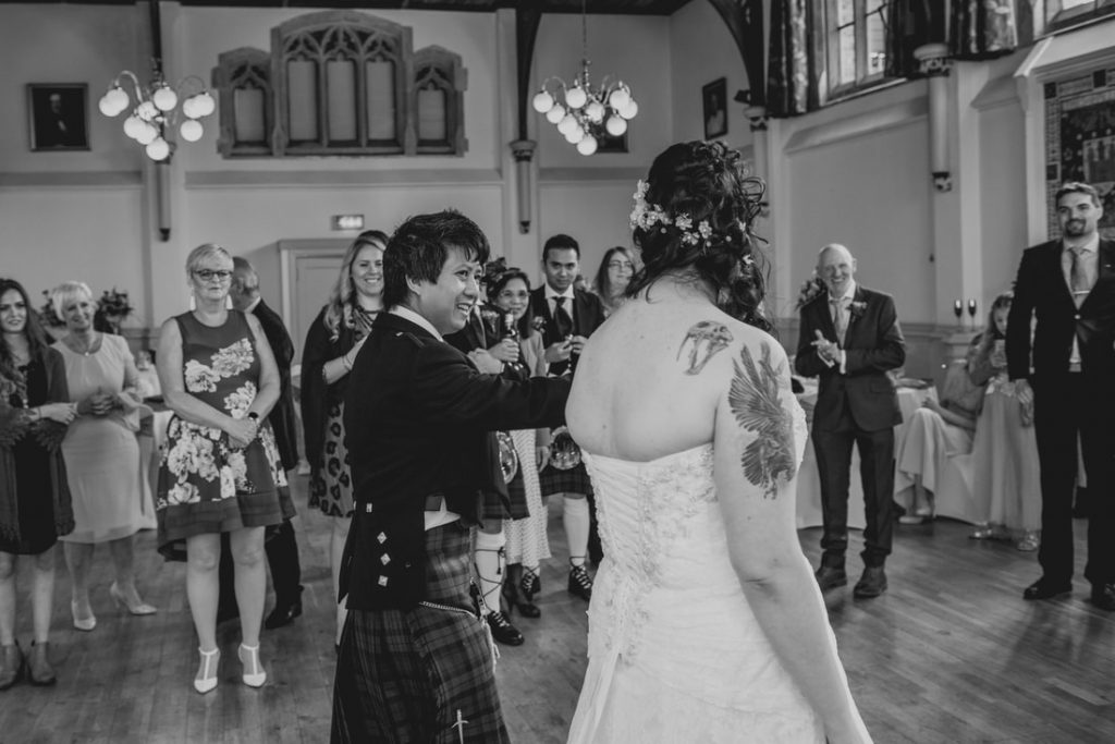 The bride and groom performing their first dance