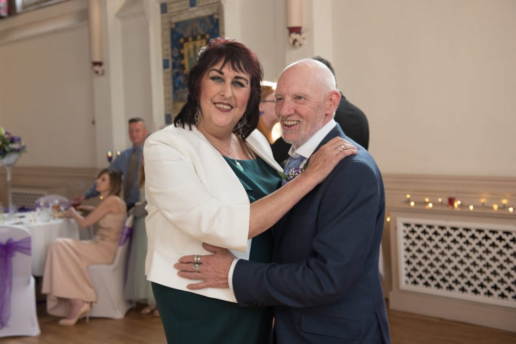Parents of the bride dancing together
