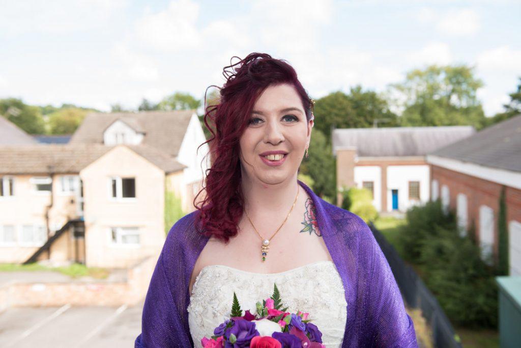 The bride wearing a purple shawl