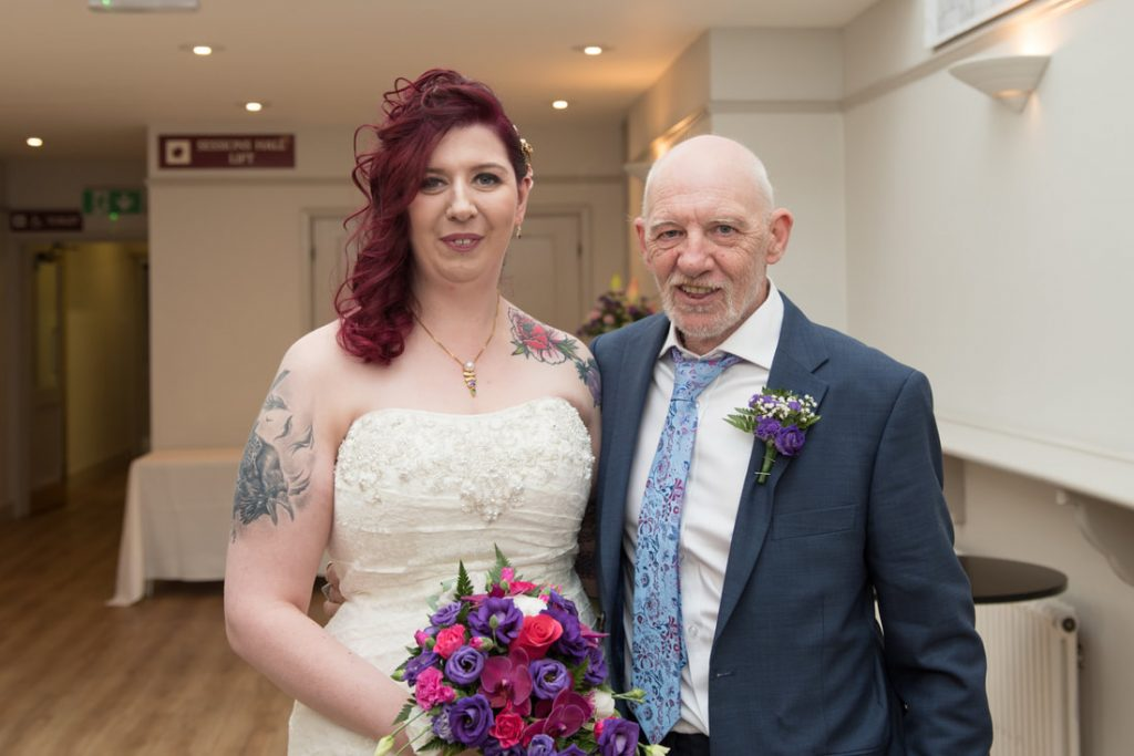 The bride and her father before the wedding ceremony