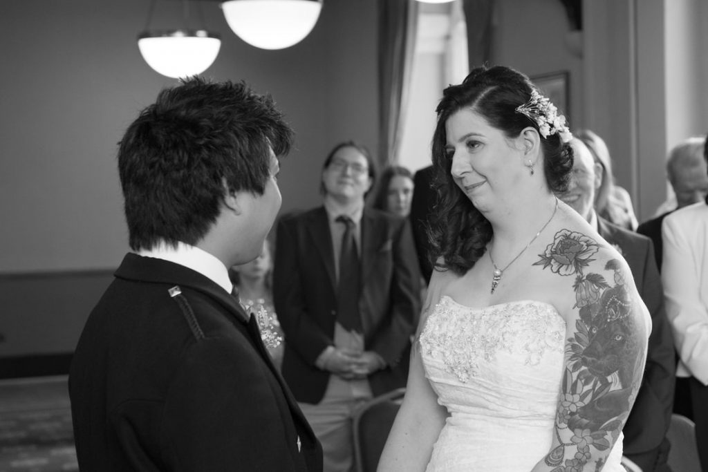 The bride and groom looking into each others eyes