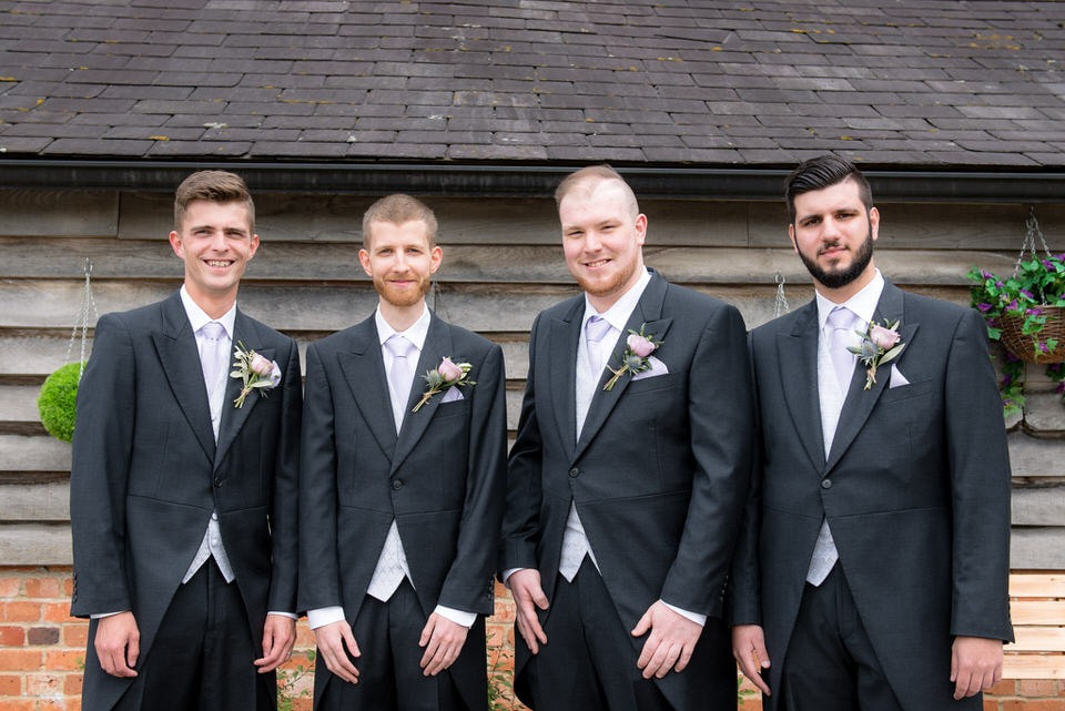 The groom with his best man and ushers