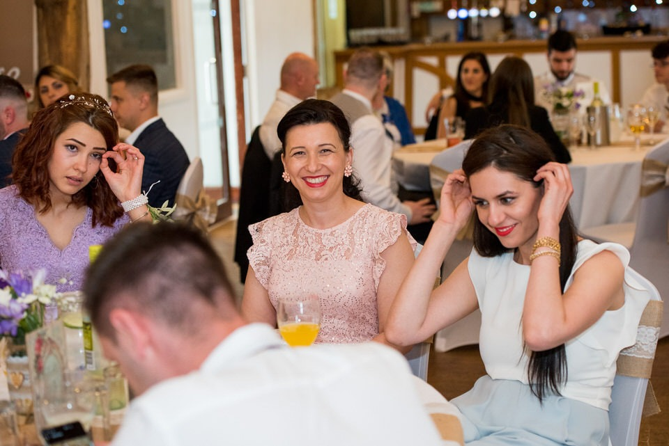 A wedding guest smiling for the camera