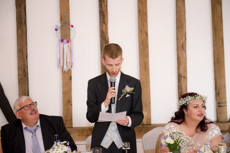 The groom delivering his speech