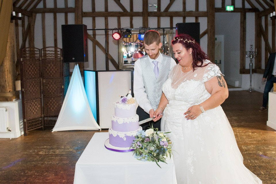 The cake cutting by the husband and wife