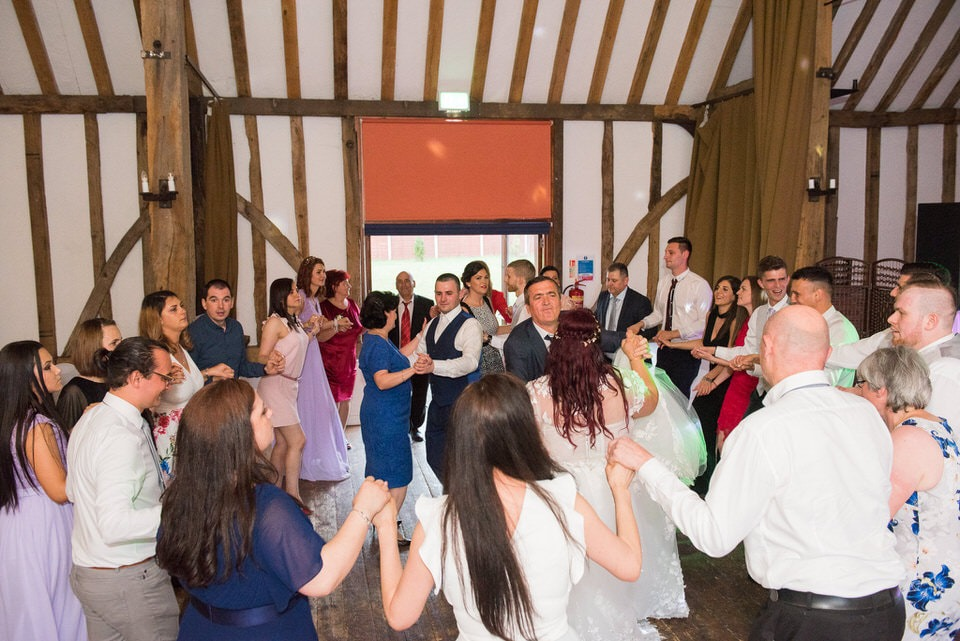 Wedding guests dancing around in a circle