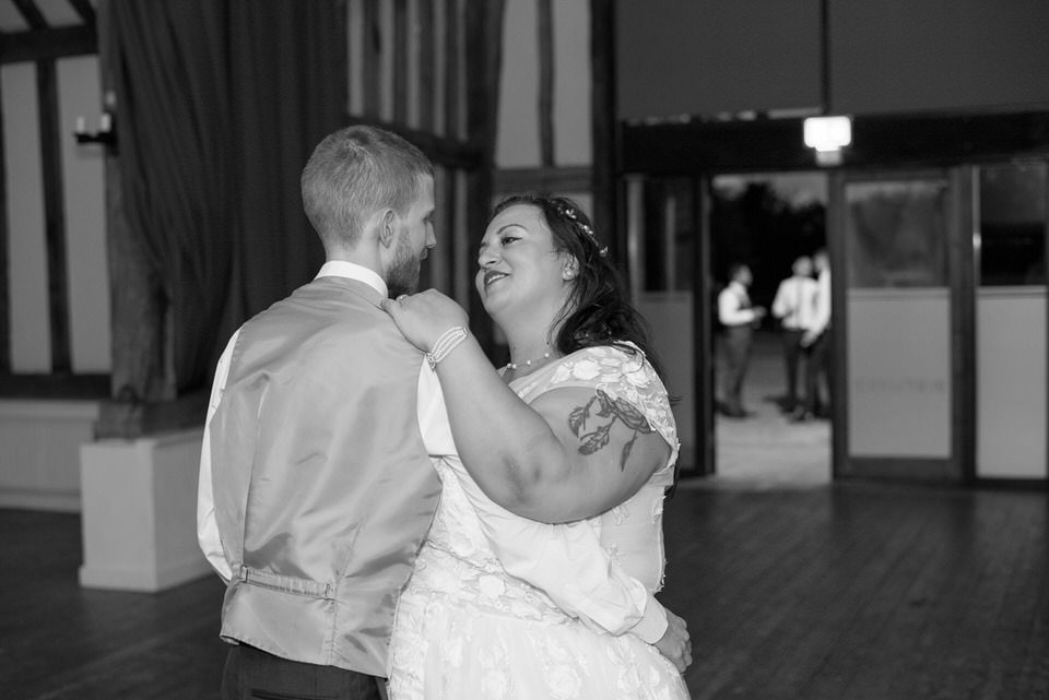 The bride and groom share a dance together on their own
