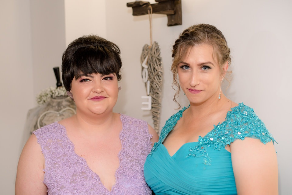 A photo of two bridesmaids together