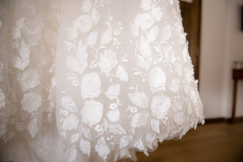 A detailed shot of the bottom of the wedding dress