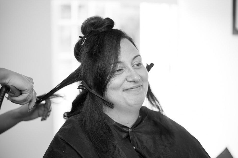 The bride having her hair straightened