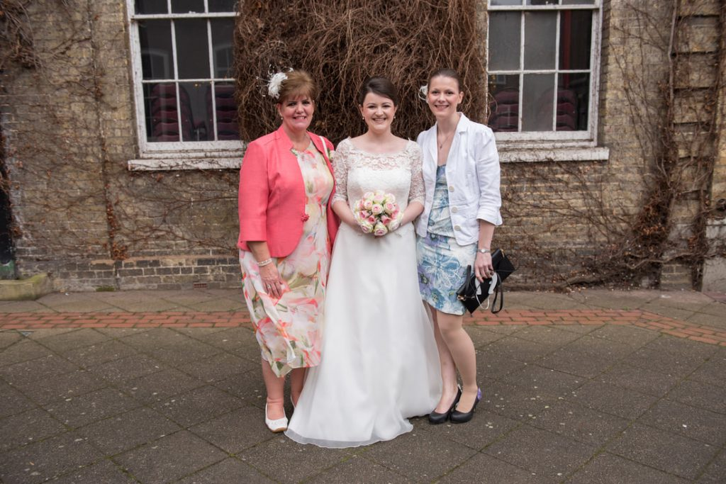 The bride with her mother and sister